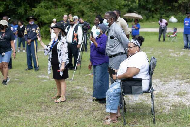 """Visitors sing along to """"Pass Me Not"""" during the 4th Annual Memorial Day Celebration at the Sweet Rest Cemetery, Monday, May 31, 2021, in Tamina. The cemetery was officially designated as a historical area after a nine-month long process led by the The Tamina Cemetery and Community Project CDC. Photo: Gustavo Huerta, Houston Chronicle / Staff Photographer / Houston Chronicle © 2021"""