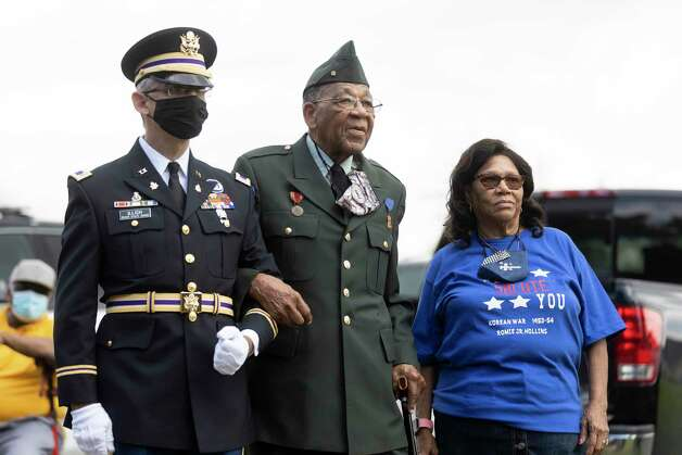 From left to right, Warrant Officer Gregory Illich, Pfc. Romie Hollins, center and his wife, Eva, prepare to walk to the speakers area during the 4th Annual Memorial Day Celebration at the Sweet Rest Cemetery, Monday, May 31, 2021, in Tamina. The cemetery was officially designated as a historial area after a nine-month long process led by the The Tamina Cemetery and Community Project CDC. Photo: Gustavo Huerta, Houston Chronicle / Staff Photographer / Houston Chronicle © 2021