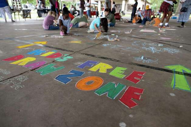 A chalk drawing area is designated to children during the 4th Annual Memorial Day Celebration at Tamina Park Community Building, Monday, May 31, 2021, in Tamina. The cemetery was officially designated as a historical area after a nine-month long process led by the The Tamina Cemetery and Community Project CDC. Photo: Gustavo Huerta, Houston Chronicle / Staff Photographer / Houston Chronicle © 2021