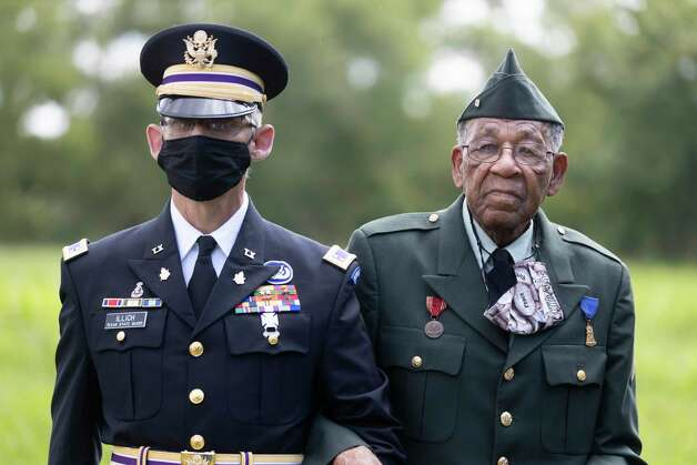 Warrant Officer Gregory Illich, left, escorts Pfc. Romie Hollins during the 4th Annual Memorial Day Celebration at the Sweet Rest Cemetery, Monday, May 31, 2021, in Tamina. The cemetery was officially designated as a historical area after a 9 month long process led by the The Tamina Cemetery and Community Project CDC. Photo: Gustavo Huerta, Houston Chronicle / Staff Photographer / Houston Chronicle © 2021