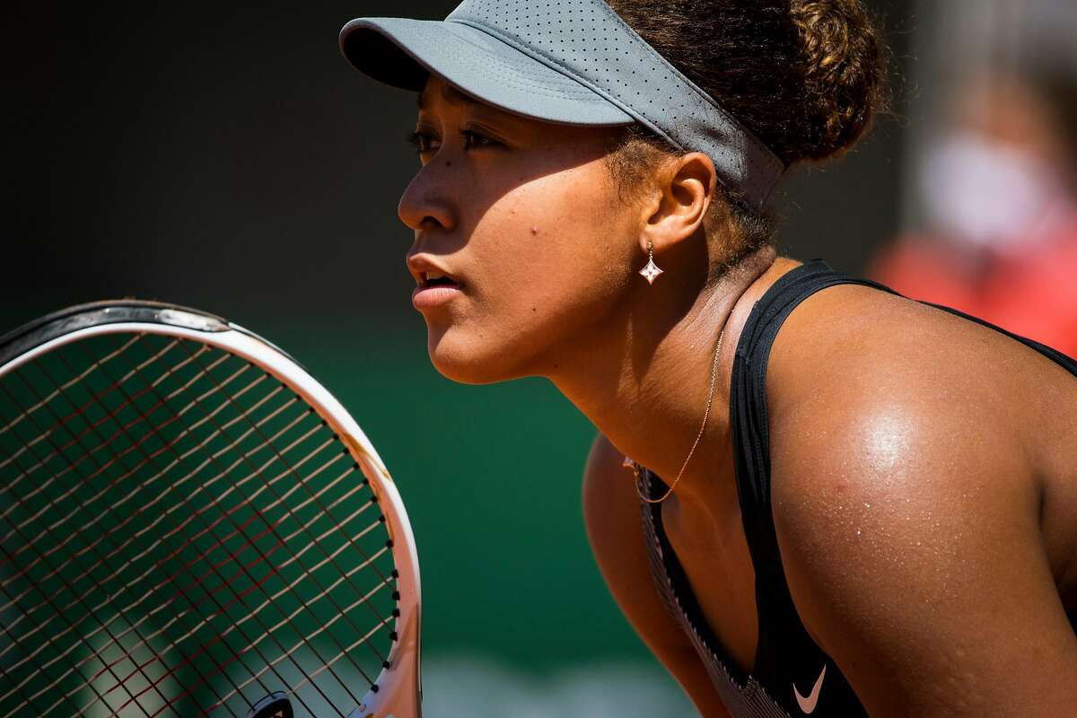 Naomi Osaka during her first round match against Patricia Maria Tig at the French Open in Paris on Sunday, May 30, 2021. Osaka dropped out of the French Open on Monday, May 31, 2021, one day after officials threatened to expel her from the season's second Grand Slam tournament if she continued to refuse to attend news conferences after her matches. (Pete Kiehart/The New York Times)