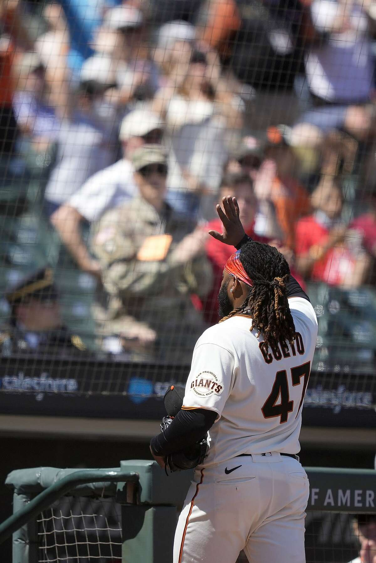 San Francisco Giants pitcher Johnny Cueto (47) waves to the crowd as he walks off the field at the end of the top of the seventh inning against the Los Angeles Angels in a baseball game Monday, May 31, 2021, in San Francisco. (AP Photo/Tony Avelar)