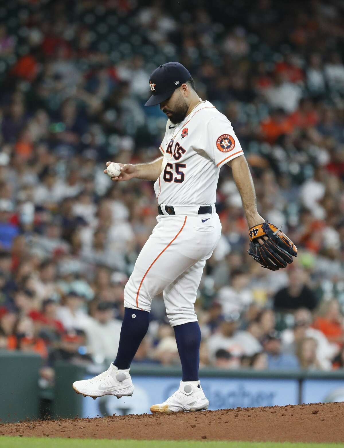 Houston Astros starting pitcher Jose Urquidy (65) reacts after giving up the first hit of the game, a double, to Boston Red Sox Christian Vazquez during the fifth inning of an MLB baseball game at Minute Maid Park, Monday, May 31, 2021, in Houston.