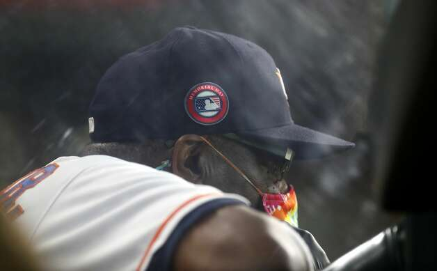 Houston Astros manager Dusty Baker Jr. (12) with a special Memorial Day patch on his ball cap in the dugout during the fifth inning of an MLB baseball game at Minute Maid Park, Monday, May 31, 2021, in Houston. Photo: Karen Warren/Staff Photographer / @2021 Houston Chronicle