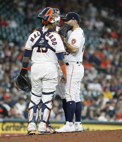 Houston Astros starting pitcher Jose Urquidy (65) chats with catcher Martin Maldonado (15) and Carlos Correa during the sixth inning of an MLB baseball game at Minute Maid Park, Monday, May 31, 2021, in Houston. Photo: Karen Warren/Staff Photographer / @2021 Houston Chronicle