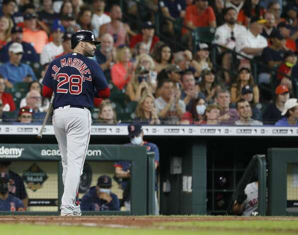 Boston Red Sox designated hitter J.D. Martinez (28) reacts after striking out against Houston Astros starting pitcher Jose Urquidy during the sixth inning of an MLB baseball game at Minute Maid Park, Monday, May 31, 2021, in Houston. Photo: Karen Warren/Staff Photographer / @2021 Houston Chronicle