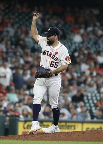 Houston Astros starting pitcher Jose Urquidy (65) reacts after striking out Boston Red Sox Xander Bogaerts to end the top of the sixth inning of an MLB baseball game at Minute Maid Park, Monday, May 31, 2021, in Houston. Photo: Karen Warren/Staff Photographer / @2021 Houston Chronicle