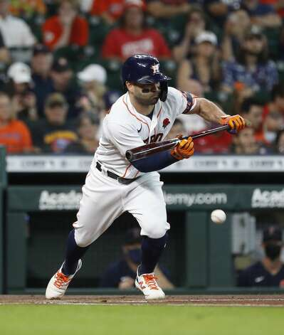 Houston Astros Jose Altuve (27) bunt grounds out during the first inning of an MLB baseball game at Minute Maid Park, Monday, May 31, 2021, in Houston. Photo: Karen Warren/Staff Photographer / @2021 Houston Chronicle