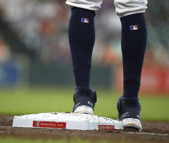 Houston Astros Carlos Correa (1) stands on second base after his single off of Boston Red Sox starting pitcher Eduardo Rodriguez during the second inning of an MLB baseball game at Minute Maid Park, Monday, May 31, 2021, in Houston. Photo: Karen Warren/Staff Photographer / @2021 Houston Chronicle