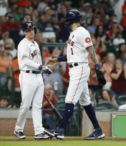 Houston Astros Carlos Correa (1) celebrates his run scored with Myles Straw (3) after Taylor Jones'sacrifice fly during the second inning of an MLB baseball game at Minute Maid Park, Monday, May 31, 2021, in Houston. Photo: Karen Warren/Staff Photographer / @2021 Houston Chronicle