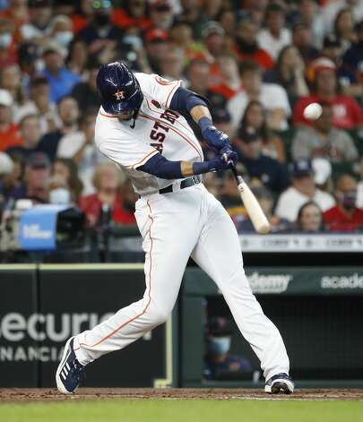 Houston Astros Taylor Jones (28) hits a sacrifice fly allowing Carlos Correa to score a run during the second inning of an MLB baseball game at Minute Maid Park, Monday, May 31, 2021, in Houston. Photo: Karen Warren/Staff Photographer / @2021 Houston Chronicle