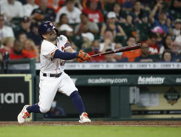Houston Astros Jose Altuve (27) hits a two-run home run during the third inning of an MLB baseball game at Minute Maid Park, Monday, May 31, 2021, in Houston. Photo: Karen Warren/Staff Photographer / @2021 Houston Chronicle
