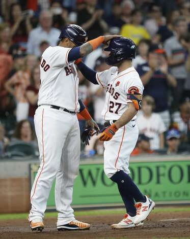 Houston Astros Jose Altuve (27) celebrates with Martin Maldonado (15) after hitting a two-run home run during the third inning of an MLB baseball game at Minute Maid Park, Monday, May 31, 2021, in Houston. Photo: Karen Warren/Staff Photographer / @2021 Houston Chronicle