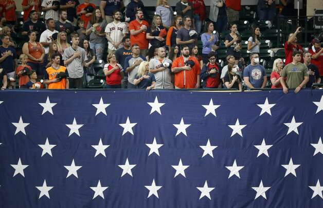A giant American flag over the scoreboard under the Crawford Boxes during the National Anthem before the start of an MLB baseball game at Minute Maid Park, Monday, May 31, 2021, in Houston. Photo: Karen Warren/Staff Photographer / @2021 Houston Chronicle