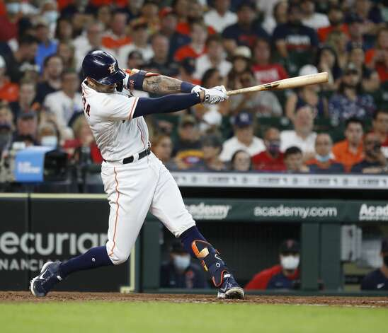 Houston Astros shortstop Carlos Correa (1) hits an RBI double during the sixth inning of an MLB baseball game at Minute Maid Park, Monday, May 31, 2021, in Houston. Photo: Karen Warren/Staff Photographer / @2021 Houston Chronicle