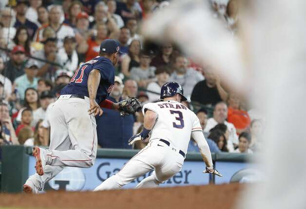 Houston Astros Myles Straw (3) slides into third base against Boston Red Sox third baseman Rafael Devers (11) on Chas McCormick's single during the sixth inning of an MLB baseball game at Minute Maid Park, Monday, May 31, 2021, in Houston. Photo: Karen Warren/Staff Photographer / @2021 Houston Chronicle