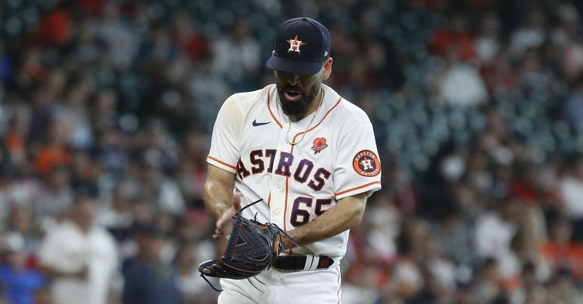 Houston Astros starting pitcher Jose Urquidy (65) reacts after striking out Boston Red Sox Xander Bogaerts to end the top of the sixth inning of an MLB baseball game at Minute Maid Park, Monday, May 31, 2021, in Houston.