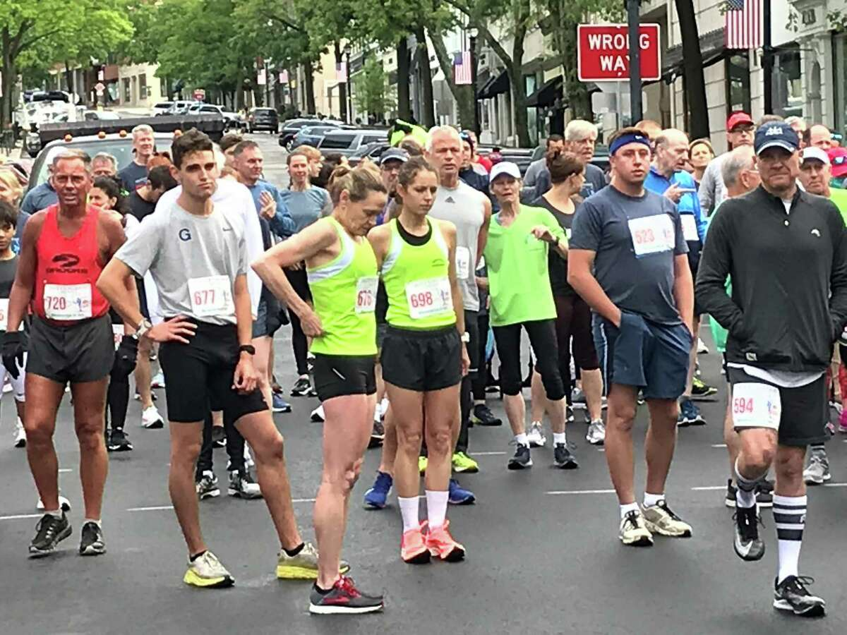 Competitors gather prior to the start of the 57th annual Jim Fixx Memorial Day 5K Run in Greenwich, Connecticut on May 31, 2021.