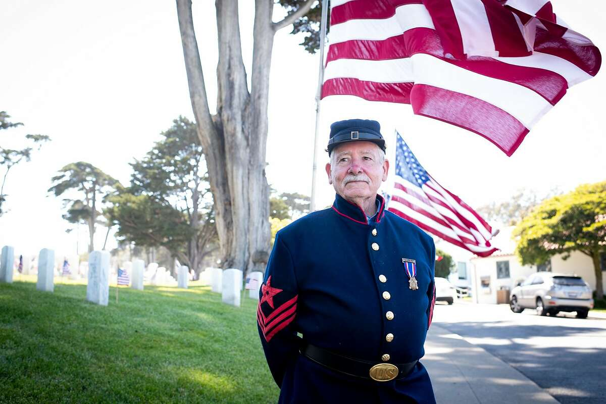 Steve Johnson of Sons of Union Veterans of the Civil War greeted visitors to San Francisco National Cemetery on Memorial Day.