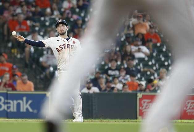 Houston Astros third baseman Alex Bregman (2) makes the throw to first base as Boston Red Sox Enrique Hernandez ground out during the eighth inning of an MLB baseball game at Minute Maid Park, Monday, May 31, 2021, in Houston. Photo: Karen Warren/Staff Photographer / @2021 Houston Chronicle