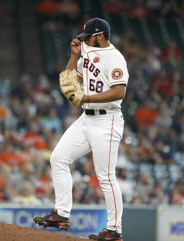 Houston Astros relief pitcher Nivaldo Rodriguez (68) wipes his face between pitches during the eighth inning of an MLB baseball game at Minute Maid Park, Monday, May 31, 2021, in Houston. Photo: Karen Warren/Staff Photographer / @2021 Houston Chronicle