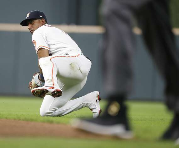 Houston Astros second baseman Robel Garcia (9) fields the sharply hit ground ball from Boston Red Sox Danny Santana for the final out of the ninth inning of an MLB baseball game at Minute Maid Park, Monday, May 31, 2021, in Houston. Photo: Karen Warren/Staff Photographer / @2021 Houston Chronicle