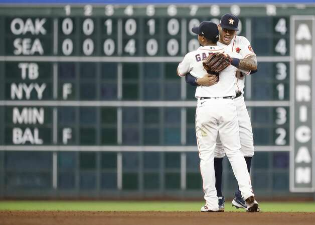 Houston Astros second baseman Robel Garcia (9) hugs Carlos Correa after catching a sharply hit ground ball from Boston Red Sox Danny Santana for the final out of the ninth inning of an MLB baseball game at Minute Maid Park, Monday, May 31, 2021, in Houston. Astros won the game 11-2. Photo: Karen Warren/Staff Photographer / @2021 Houston Chronicle