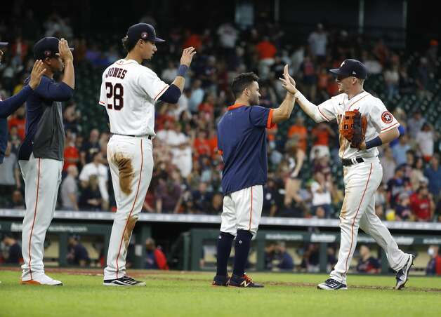 Houston Astros Jose Altuve high-fives Myles Straw after the Astros beat the Boston Red Sox 11-2 in an MLB baseball game at Minute Maid Park, Monday, May 31, 2021, in Houston. Photo: Karen Warren/Staff Photographer / @2021 Houston Chronicle