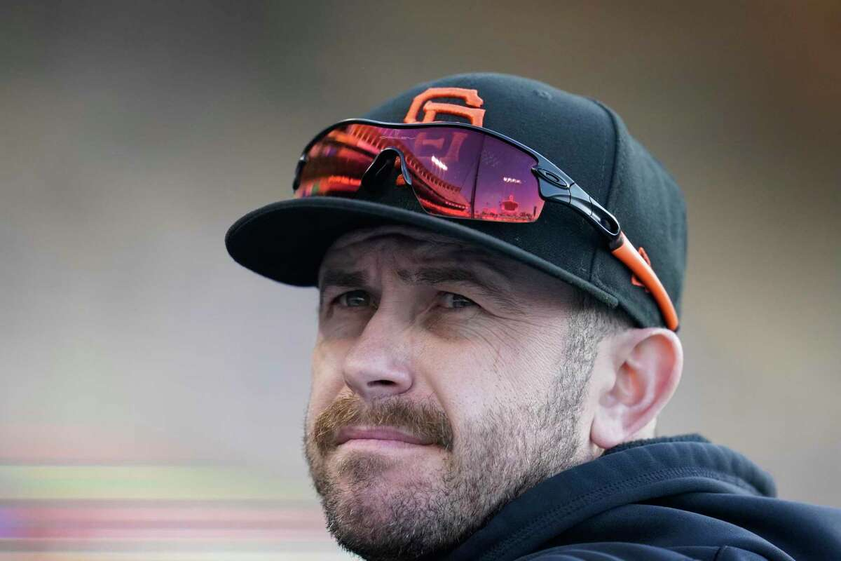 San Francisco Giants third baseman Evan Longoria looks on from the dugout during a baseball game against the Los Angeles Dodgers Friday, May 28, 2021, in Los Angeles. (AP Photo/Marcio Jose Sanchez)