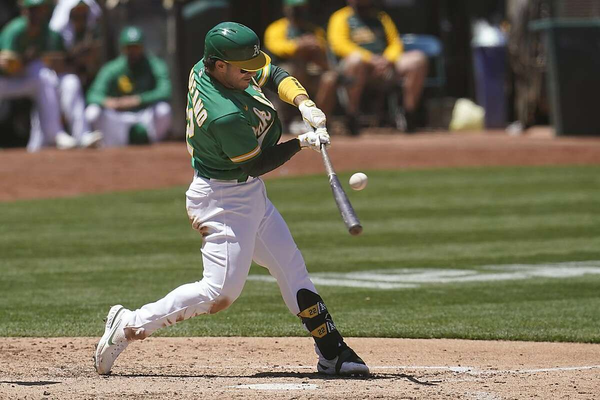 Oakland Athletics' Ramon Laureano hits an RBI-single against the Seattle Mariners during the fourth inning of a baseball game in Oakland, Calif., Wednesday, May 26, 2021. (AP Photo/Jeff Chiu)