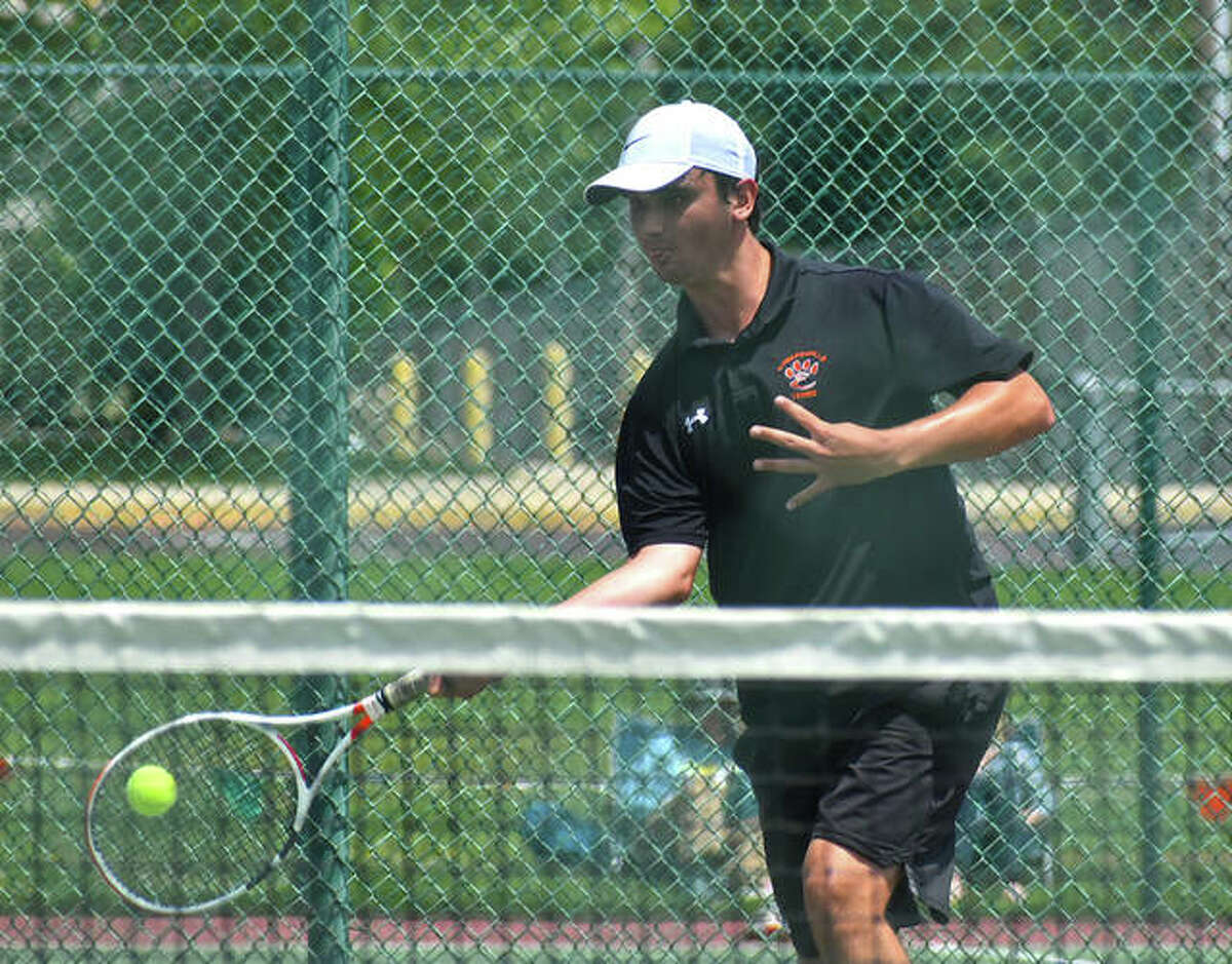 Edwardsville's Michael Karibian hits a forehand shot in his No. 3 singles championship match at the Southwestern Conference Tournament on Monday in O'Fallon.