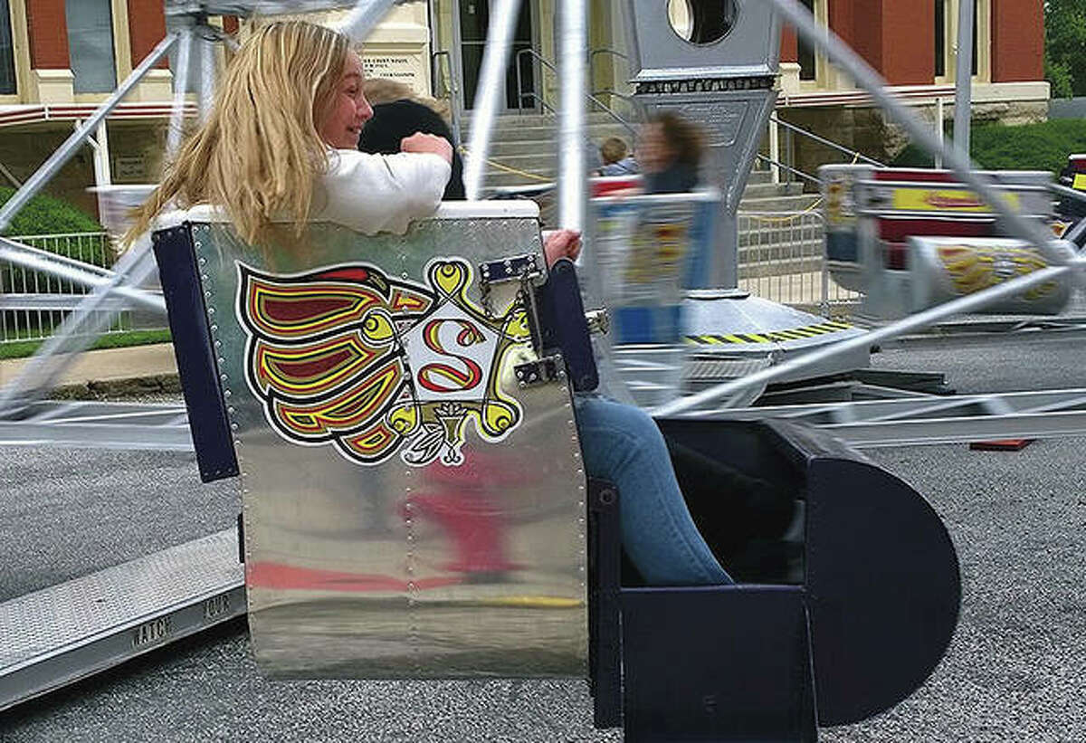 A group of girls enjoys being spun around Friday on one of the rides at the Winchester Carnival.
