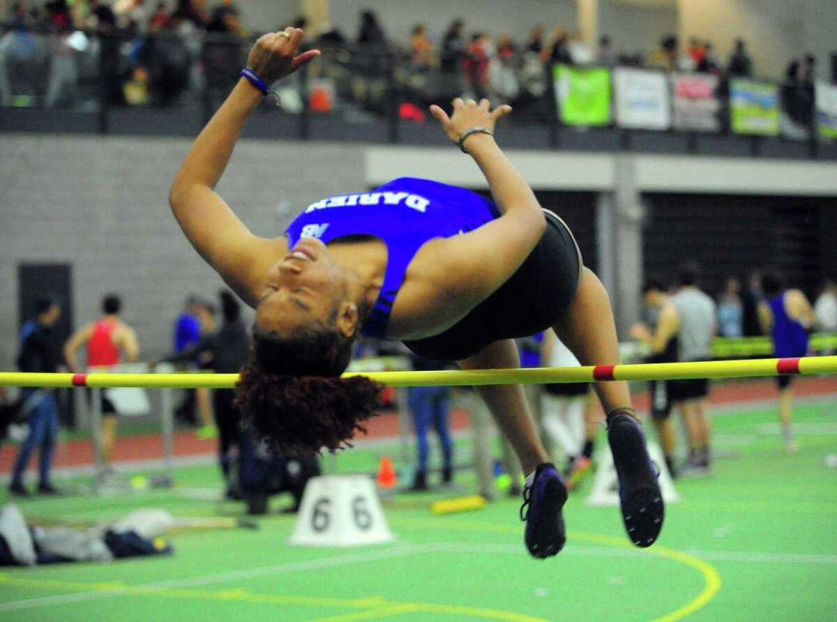 Darien's Chelsi Chevannes competes in the high jump during FCIAC Track Championship action in New Haven, Conn., on Thursday Feb. 6, 2020.