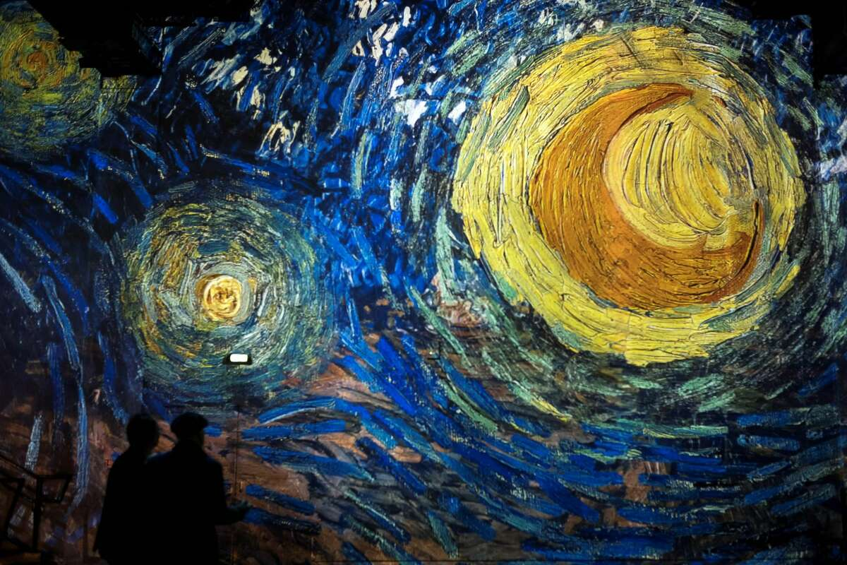 People attend a press visit of a immersive exhibition devoted to painter Vincent Van Gogh by multimedia artist Gianfranco Iannuzzi, on February 8, 2019, at