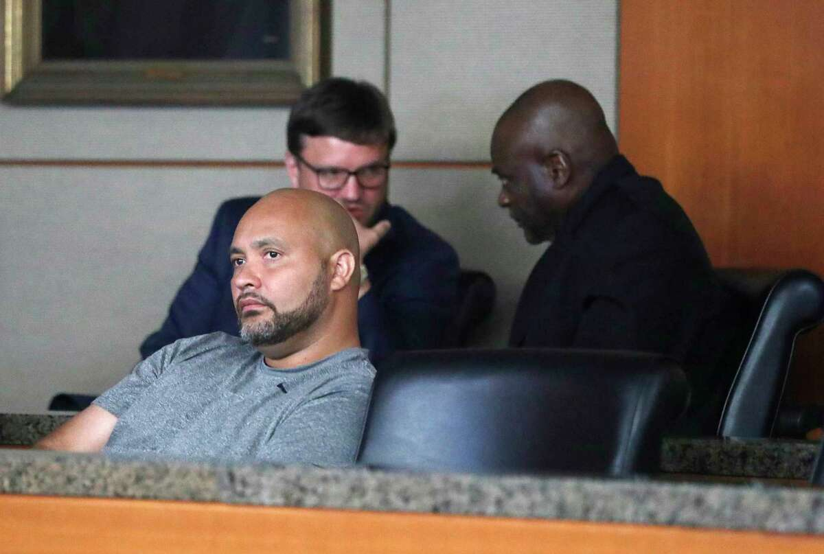 Former HPD officer Steven Bryant, forground, and Gerald Goines, background, turn themselves in at the Civil Courthouse, Friday, August 23, 2019, as charges were announced for those officers involved in the Harding Street Raid.