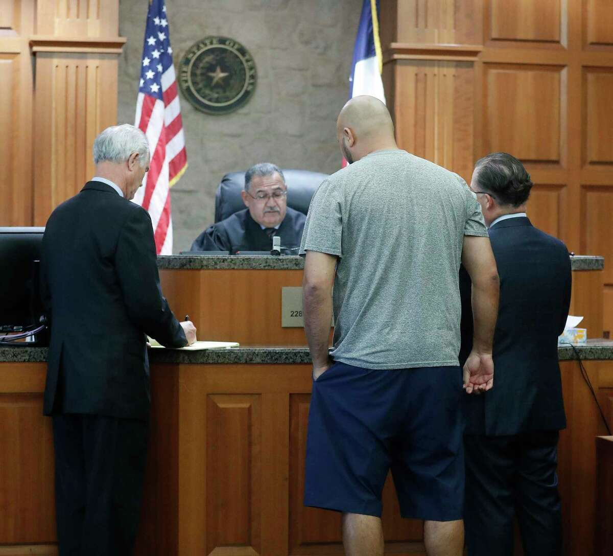 Former HPD officer Steven Bryant faces the judge as he and Gerald Goines turned themselves in at the Civil Courthouse, Friday, August 23, 2019, as charges were announced for those officers involved in the Harding Street Raid.