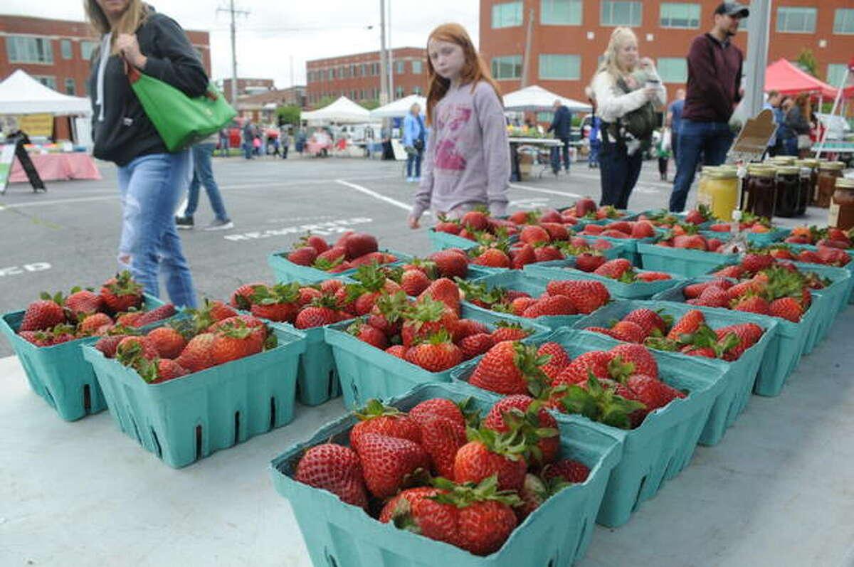 FILE - Fresh strawberries at the Land of Goshen Market.