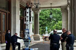 State Capitol police found at least three bullet holes on the morning of June 1, 2021 at the Capitol's south portico, which apparently were from an incident overnight. Police are shown inspecting the damage and briefing Gov. Ned Lamont.