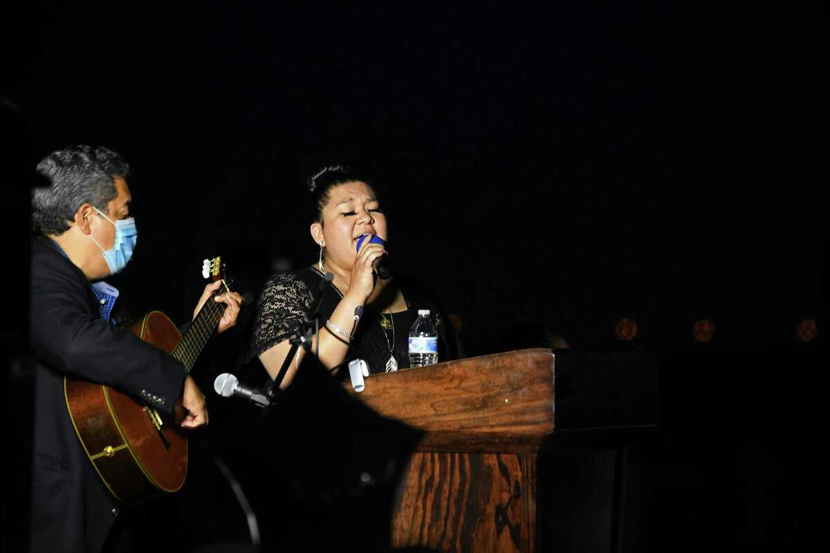 Patsy Quintero performs for her first time after battling thyroid cancer in honor of those who passed away from COVID-19 at the Light of Hope ceremony, Monday May 31, 2021.