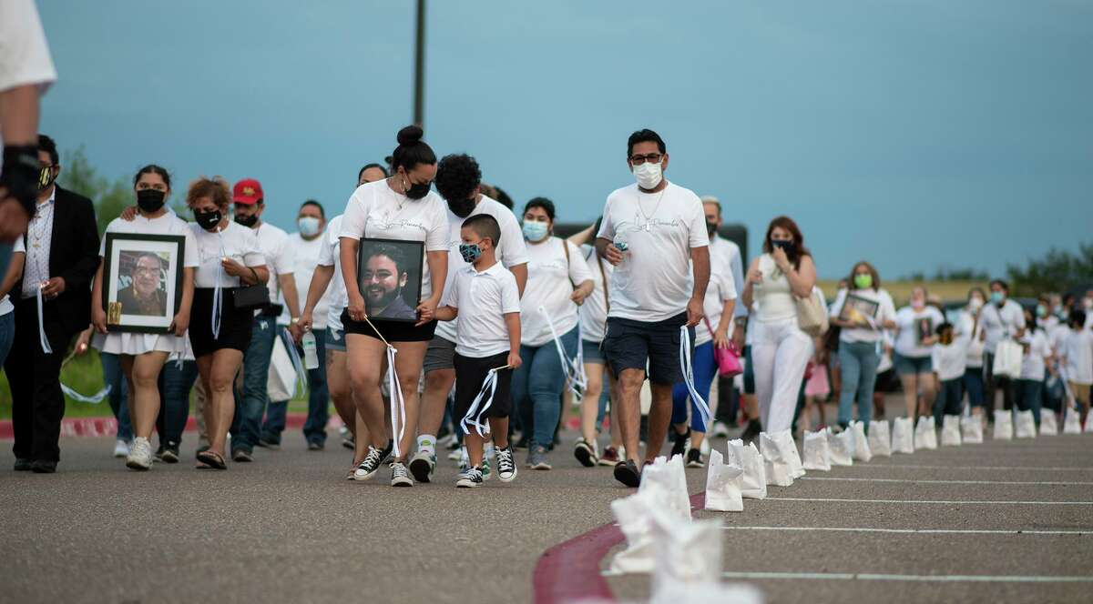Members of the community who have lost a loved one to COVID-19 and their support circles participate in the City of Laredo's Lights of Hope Remembrance Walk onMonday, May 31, 2021 around Uni-Trade Stadium.