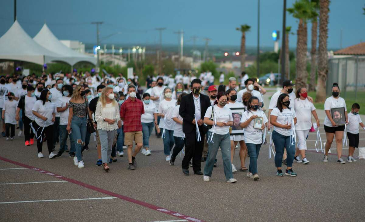 Members of the community who have lost a loved one to COVID-19 and their suppor circles participate in the City of Laredo's Lights of Hope Remembrance Walk, Monday, May 31, 2021, around Uni-Trade Stadium.