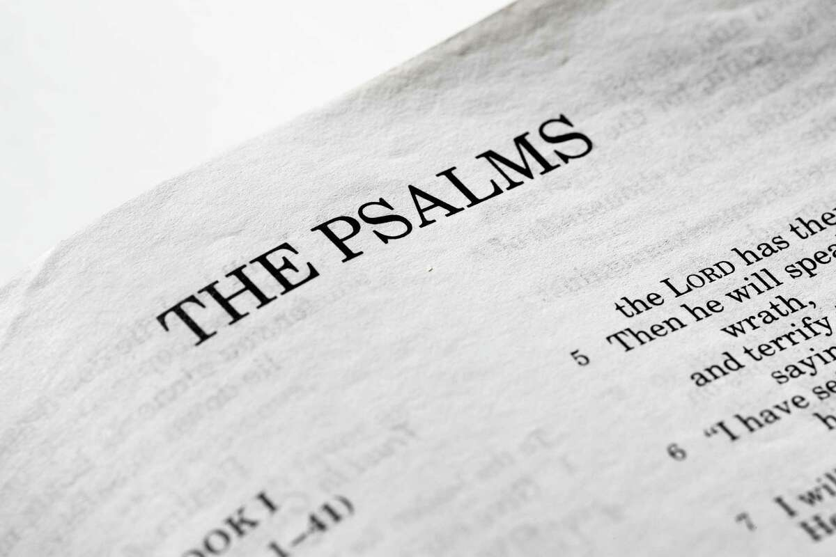 A macro detail of the book of psalms.