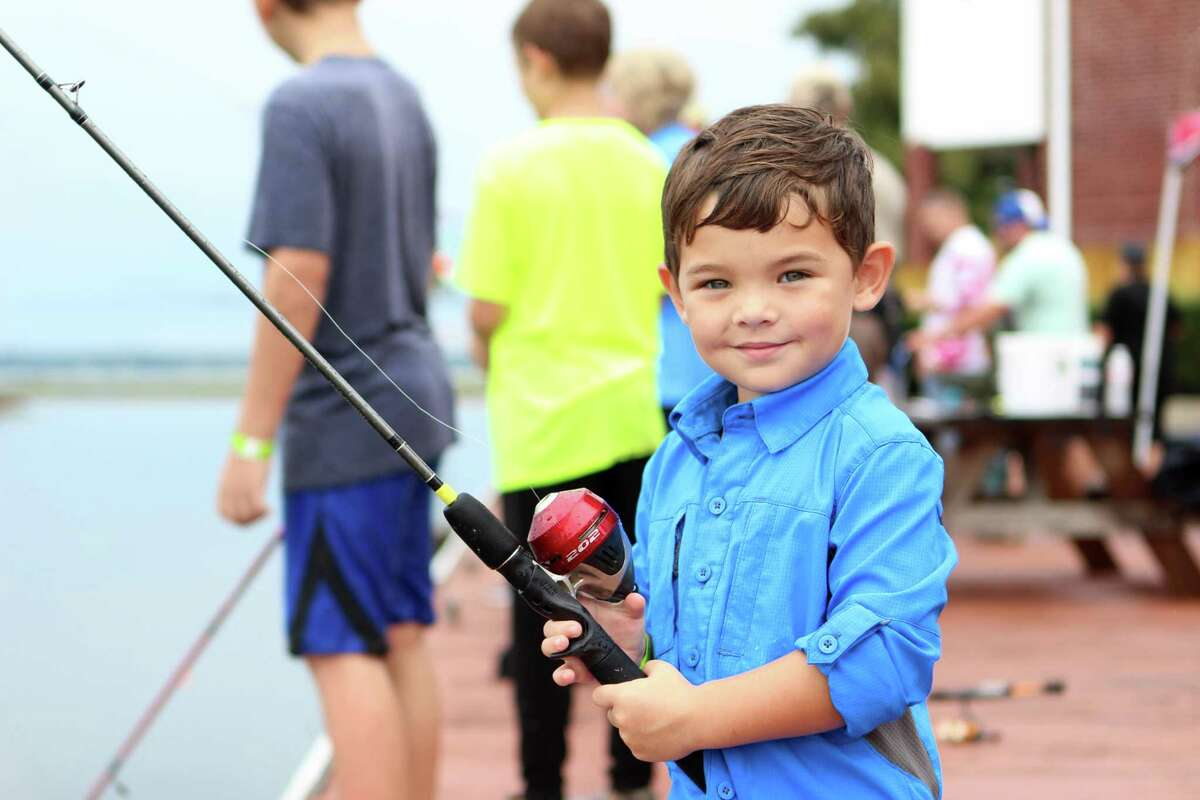 Colton Stryker, 3, fishes off of a pier during Kids Fish Fest Saturday, Sept. 22, 2018 at Walden Marina. This was the second Kids Fish Fest, organized by Texas Trophy Catfish Association.