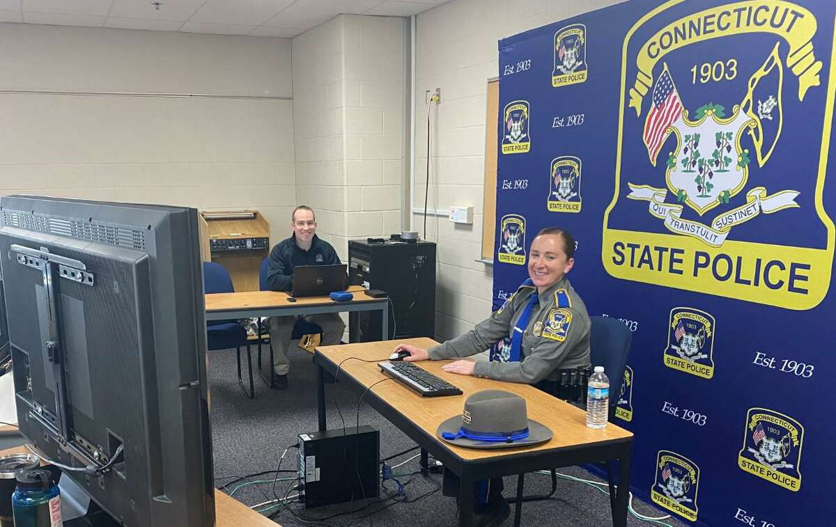 State Police Sgt. Kate Cummings, an eight-year veteran of the state police who has also served at the Connecticut State Police Training Academy as the statewide D.A.R.E. coordinator, holding a Zoom meeting on social media safety with parents.