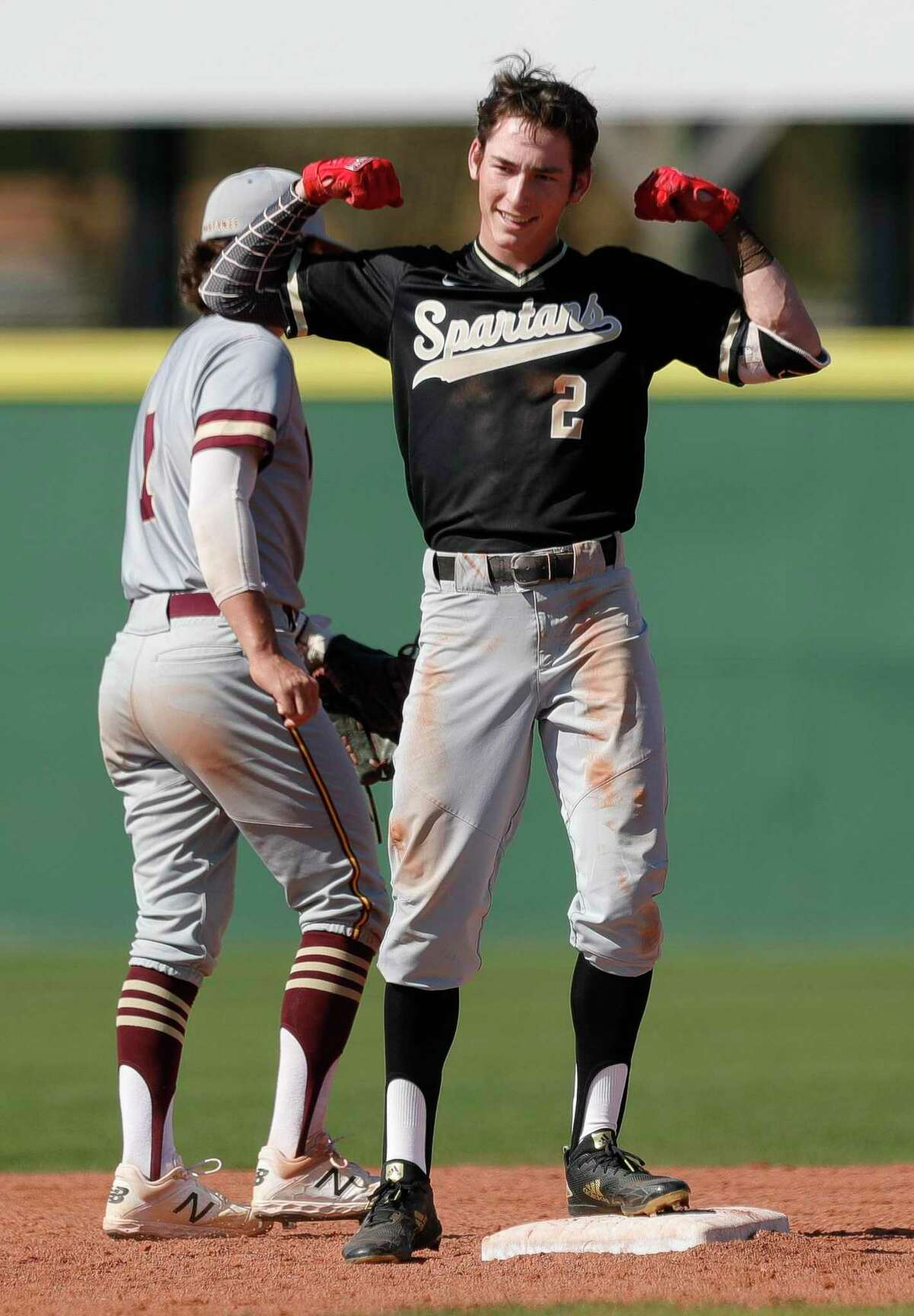 Conner Westenburg #2 of Porter reacts after hitting a 2-RBI double during the fifth inning of a high school baseball game at Porter High School, Friday, March 6, 2020, in Porter.