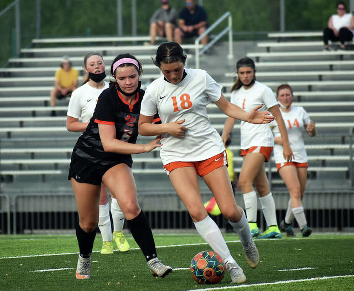 Edwardsville's Gracie Burroughs, left, battles for possession with Waterloo's Sophie Colson during a game inside the District 7 Sports Complex on May 3 in Edwardsville.