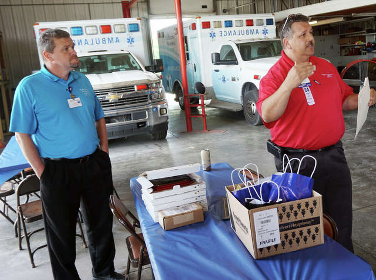 Brad Goacher, chief operating officer of Alton Memorial Hospital, and EMS manager Jason Bowman presented awards to some of the top-performing paramedics and EMTs during the EMS Week picnic May 21 in Bethalto.
