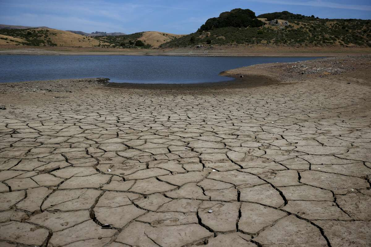 Dry cracked earth is visible as water levels are low at Nicasio Reservoir on May 28, 2021 in Nicasio, California. Marin County is under mandatory water-use restrictions that orders residents to refrain from washing cars at home, refilling pools and watering lawns once a week. According to the U.S. Drought Monitor, 16% of California is in exceptional drought, the most severe level of dryness.