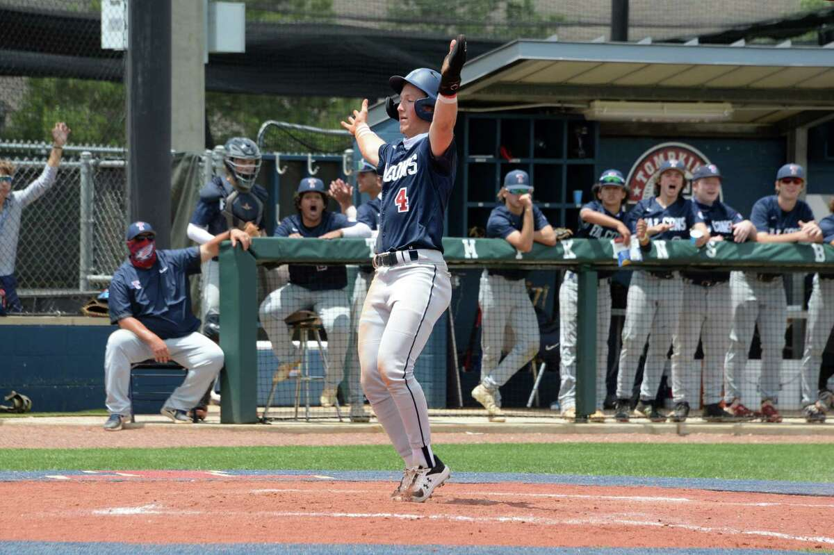 Will Stark (4) of Tompkins celebrates as he tags home plate during the fourth inning of a 6A Region III bi-district baseball playoff game between the Tompkins Falcons and the Elkins Knights on Saturday, May 8, 2021 at Tompkins HS, Katy, TX.