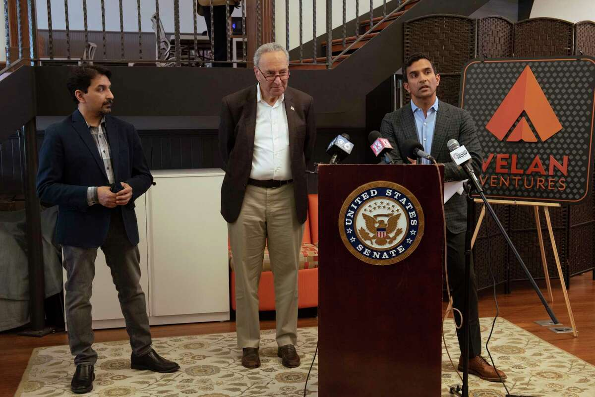 Co-founder Guha Bala, right, speaks during a press conference with his brother and co-founder Karthik Bala, left, and U.S. Senate Majority Leader Charles Schumer during the senator's visit to Velan Studios on Tuesday, June 1, 2021 in Troy, N.Y. The senator is pushing for federal support to boost Capital Region's burgeoning video game industry and establish the region as global hub for games. (Lori Van Buren/Times Union)